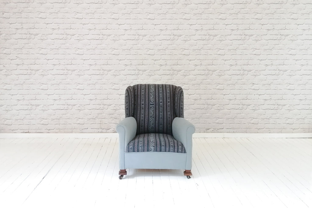 A late Victorian wing-back armchair in vintage hand woven Indonesian sarong & grey linen