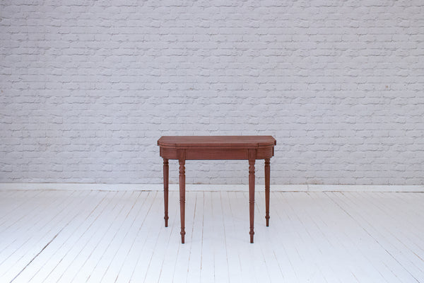 An elegant Georgian (1714-1837) mahogany folding card table with ebony stringing