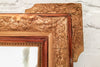 An antique French gilt & gesso mirror with original glass