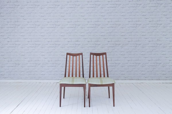 A pair of original 70s G-Plan slat back dining chairs