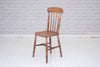 A Victorian (1837-1901) English pine kitchen chair