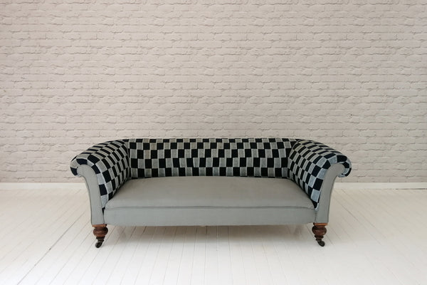 A Victorian Chesterfield sofa upholstered in vintage Ewe cloth & grey linen