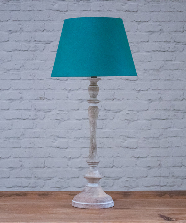 Moonbeam table lamp with teal parchment shade