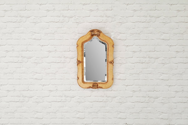 A vintage gilded wall mirror