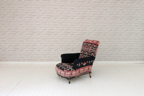 A Victorian Howard style armchair in beautiful vintage ceremonial Indonesian Ikat