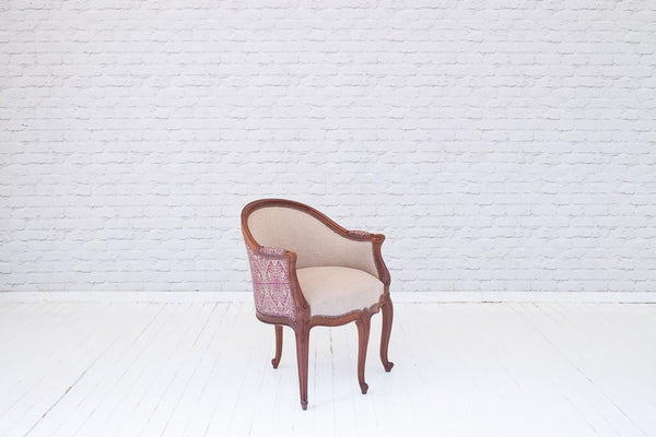 A Victorian mahogany framed occasional chair with hand-printed Egyptian silk back panel detail