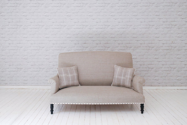 An 19th century French sofa in Lithuanian linen with Asoke scatter cushions