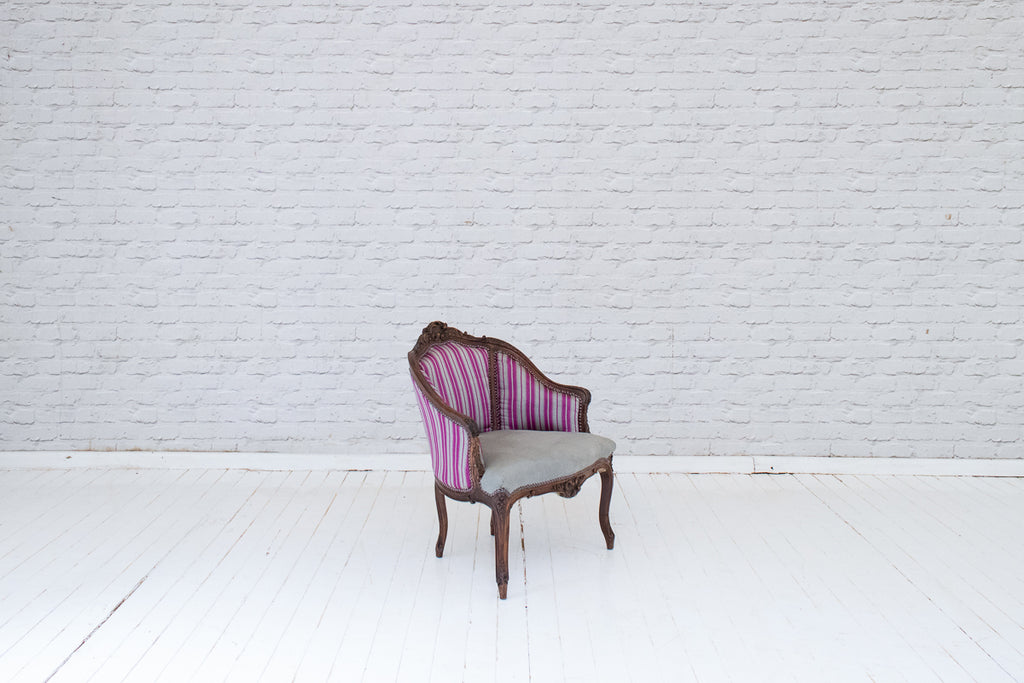 An antique French Louis armchair striped silk & Volga linen