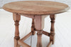 A solid English oak stool or side table