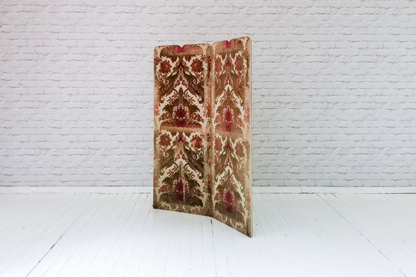 A vintage velour folding screen