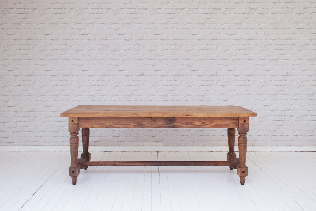 A Victorian English pine kitchen table on turned legs