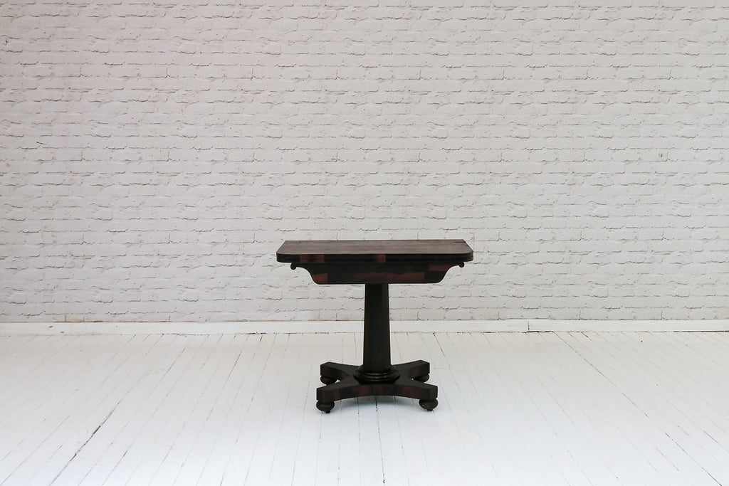 An early 19th Century rosewood card table