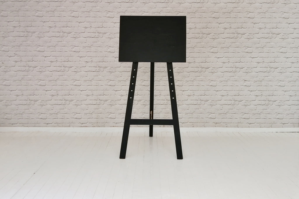 A black board on an A frame easel