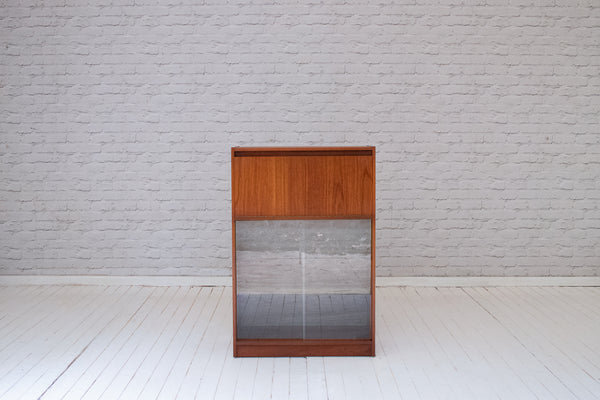 A 1970's teak bureau with glass fronted bookcase below