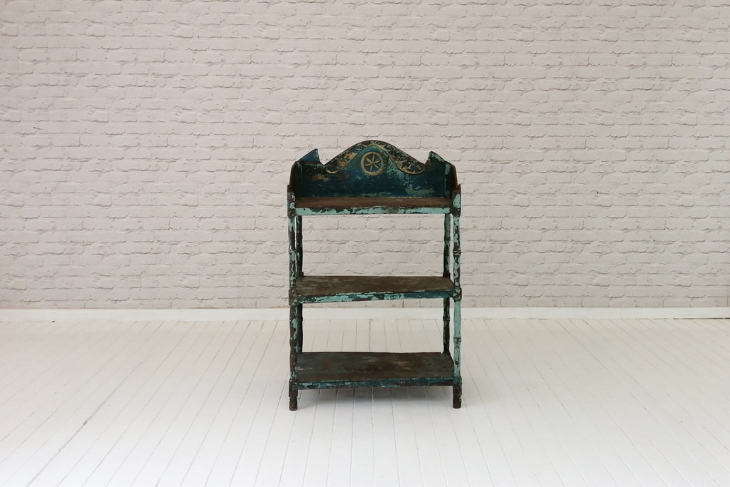 An stunning shelving unit with original distressed blue paintwork