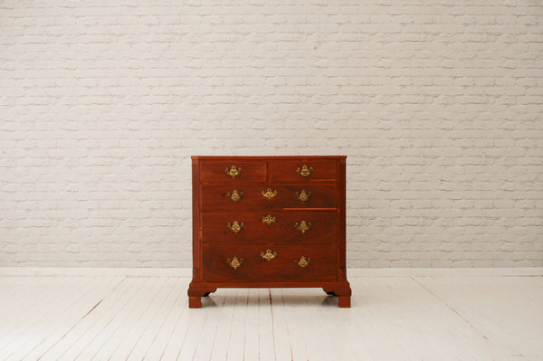 An 18th century mahogany chest of drawers with brass fretted handles