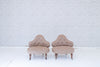 A pair of antique French buttoned fireside chairs / Armchairs