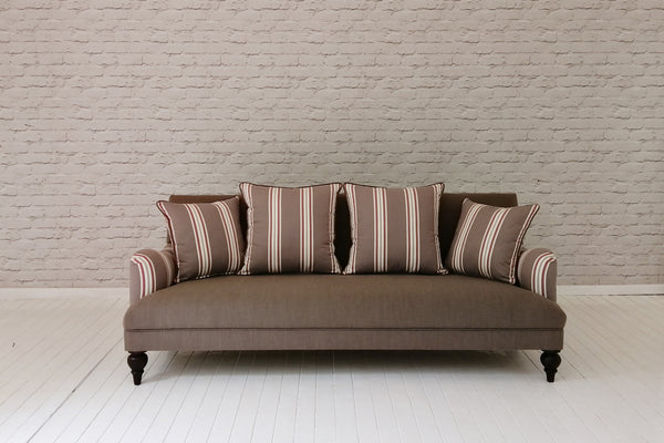 A contemporary three seater sofa in Foy & Co fabric