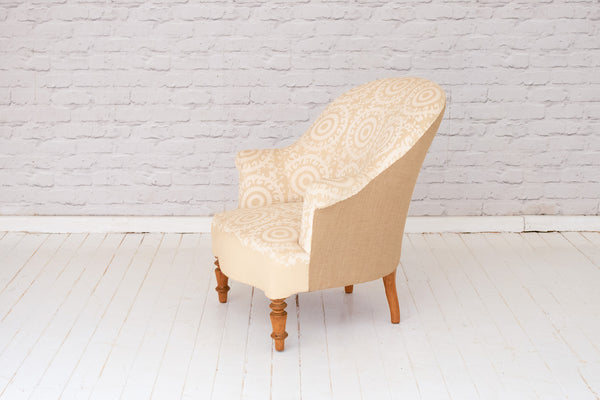 A Victorian (1837-1901) nursing chair in hand printed cotton from the Alef Gallery, Cairo