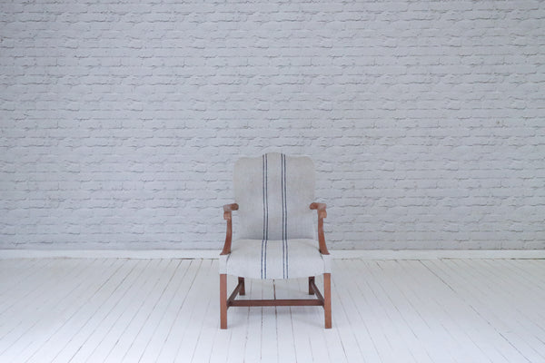 An Edwardian (1890 - 1910) mahogany framed armchair upholstered in Hungarian sackcloth