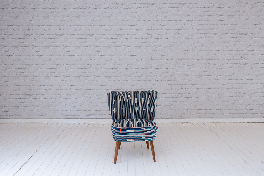 A 1950s German fireside chair in vintage Ivorian Baule cloth