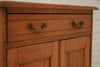 A vintage English oak two cupboard with single drawer