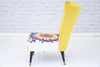 A 1950s nursing chair in hand printed Egyptian cotton and sunburst yellow velvet