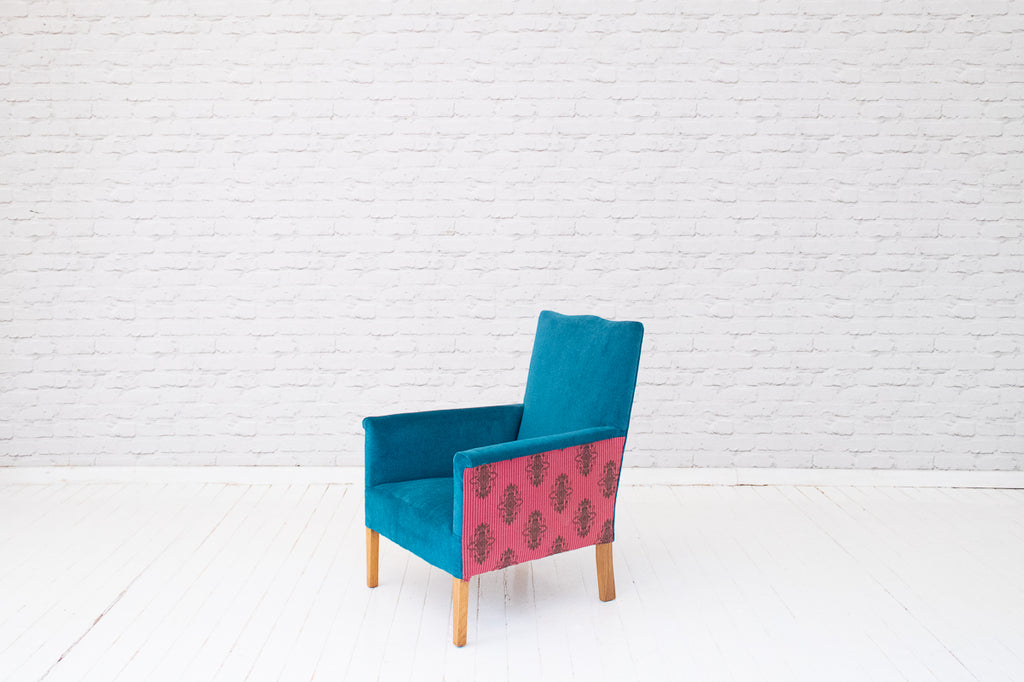 An Edwardian armchair in teal velvet with hand-printed Egyptian silk side panels from Alef Gallery, Cairo
