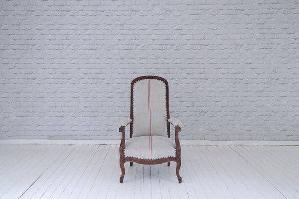 A high backed Victorian armchair upholstered in Hungarian sackcloth