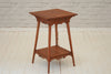 An Edwardian mahogany two tier side table