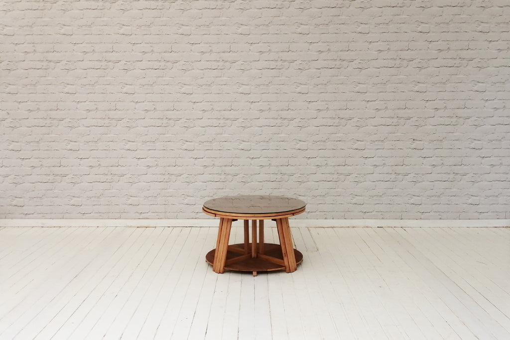 A retro circular coffee table with four smaller fitted tables under