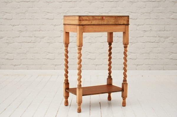 A 1930's oak cutlery table on barley-twist legs / side table