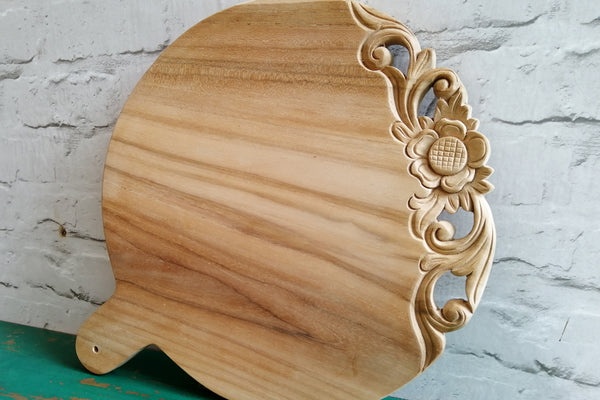Recycled teak chopping boards with hand carving detail