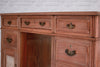 A charming Victorian walnut twin pedestal desk with decorative relief door panels