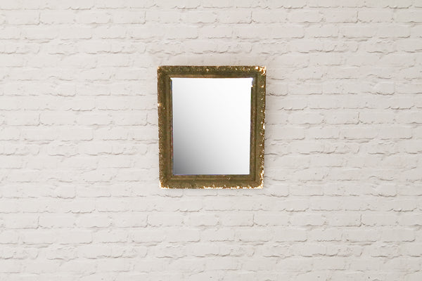 An antique gesso mirror