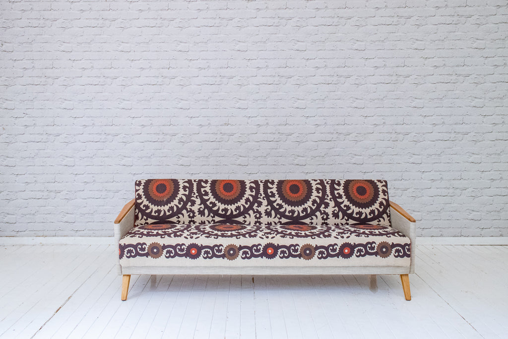 A vintage 1940s sofa bed in hand-printed jute by Alef Gallery, Cairo