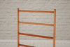 A vintage English pine towel rail
