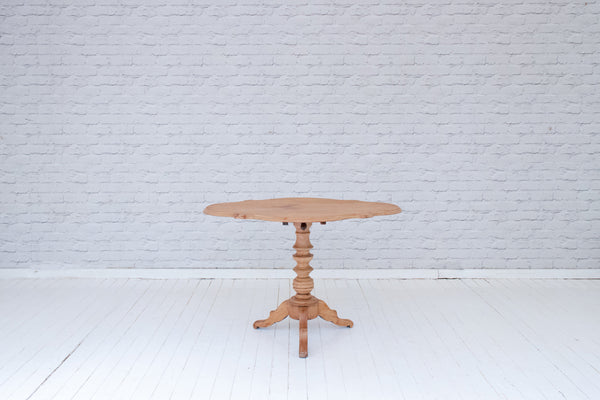 An antique French tilt-top occasional table