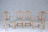 A set of four vintage dining chairs with Foy & Co striped bases