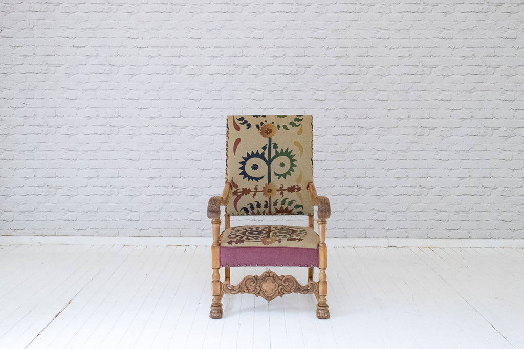 An ornately carved antique oak  hallway chair with hand-printed cotton silk from Alef Gallery, Cairo