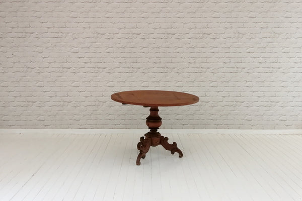 An antique Javanese side table or small dining/breakfast table