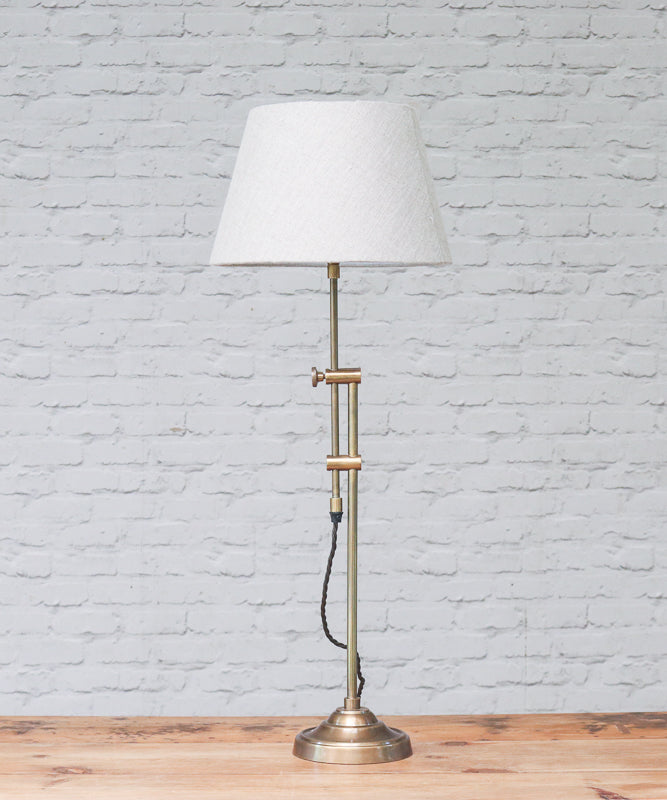 Slider table lamp in brass with streight empire lampshade in natural linen