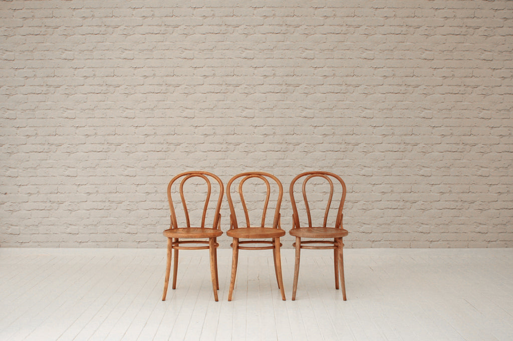 A set of three vintage bentwood café / dining chairs