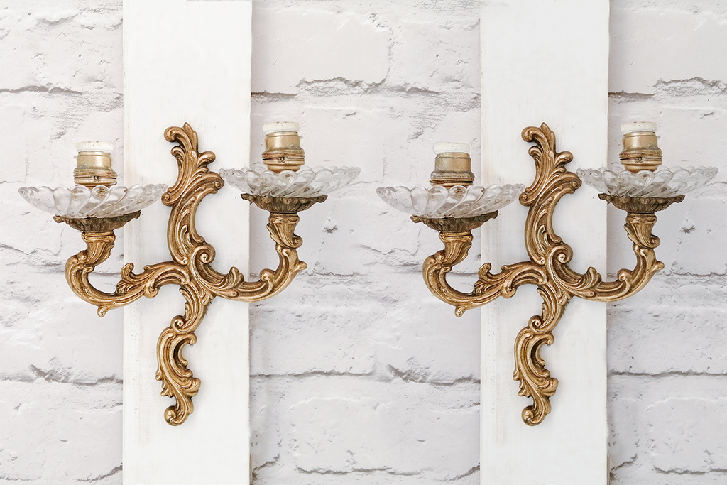 A pair of antique Eygptian brass wall sconces