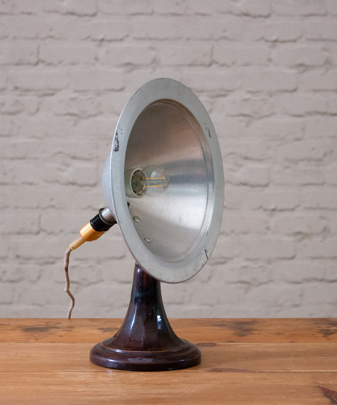 A vintage ceramic & tin lamp