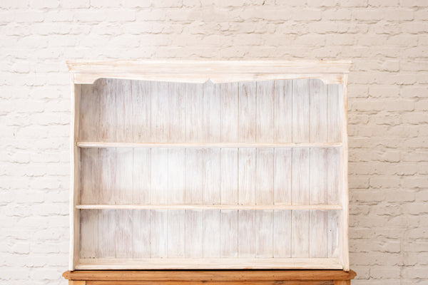 A whitewashed English pine shelving rack