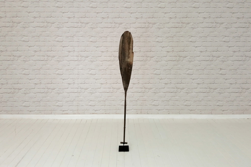Antique Borneo paddle on stand