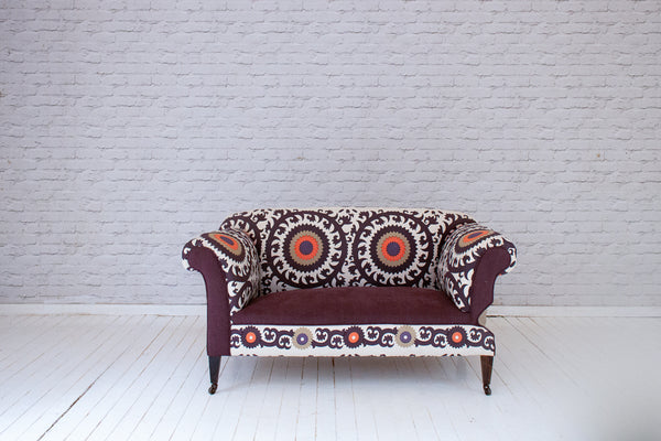 An Edwardian drop-arm cottage sofa in hand-printed Suzani-style cotton by Alef Gallery, Cairo