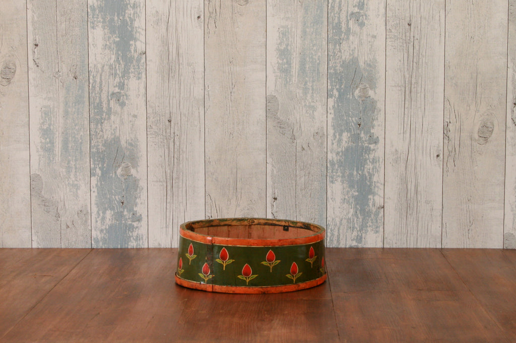 A hand painted wooden fruit bowl