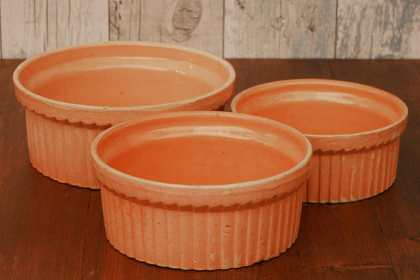 A set of three vintage French terracotta cassoulet dishes
